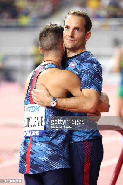 Valentin Lavillenie of France and Renaud Lavillenie of France embrace during the Men's Pole Vault qualification during day two of 17th IAAF World...