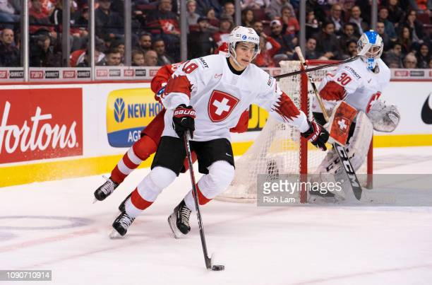 Valentin Nussbaumer of Switzerland skates with the puck in the Bronze Medal game of the 2019 IIHF World Junior Championship against Russia on January...