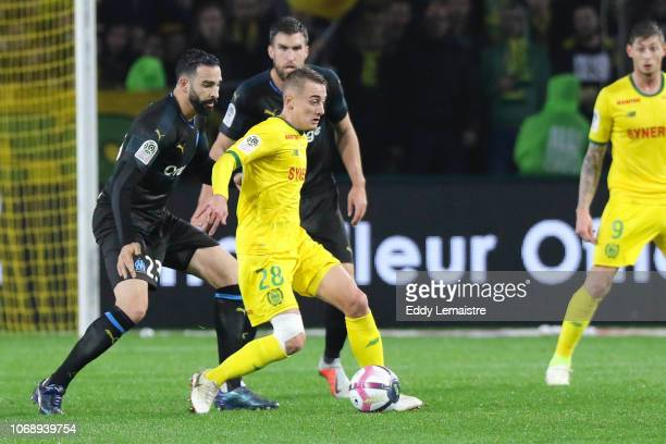 Valentin Rongier of Nantes between Adil Rami of Marseille and Kevin Strootman of Marseille during the French Ligue 1 match between FC Nantes and...