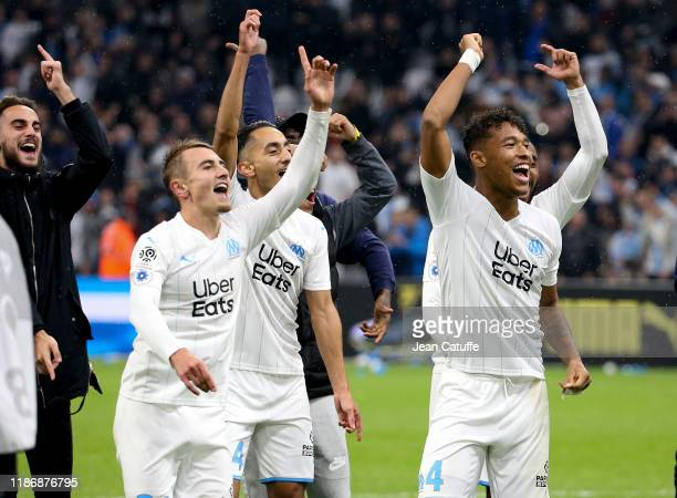 Valentin Rongier, Saif Eddine Khaoui, Boubacar Kamara and teammates of Marseille celebrate the victory with the supporters following the Ligue 1...