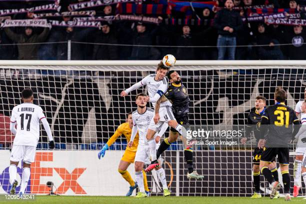 Valentin Stocker of Basel battles for the ball with Giorgos Merkis of Apoel during the UEFA Europa League round of 32 second leg match between FC...