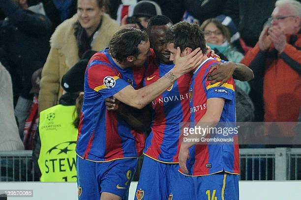 Valentin Stocker of Basel celebrates with teammates after scoring his team's first goal during the UEFA Champions League round of sixteen first leg...