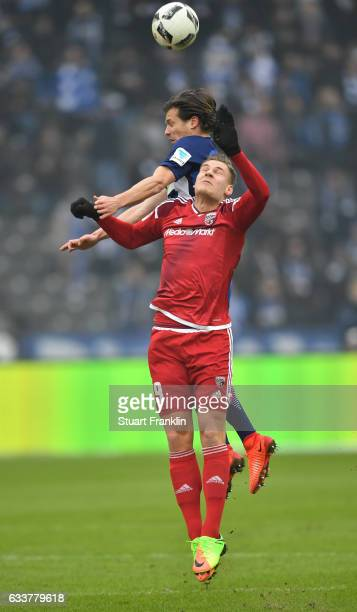 Valentin Stocker of Berlin is challenged by Max Christiansen of Ingolstadt during the Bundesliga match between Hertha BSC and FC Ingolstadt 04 at...