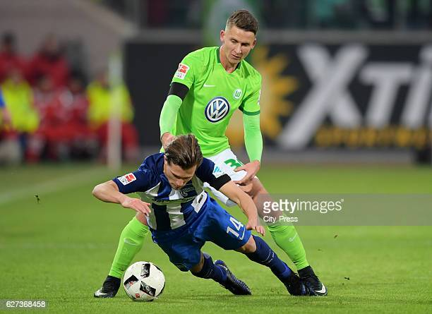 Valentin Stocker of Hertha BSC and Paul Seguin of VfL Wolfsburg during the game between VfL Wolfsburg and Hertha BSC on december 3 2016 in Wolfsburg...