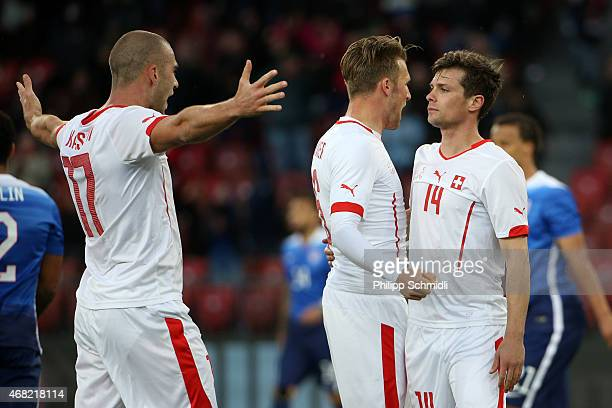 Valentin Stocker of Switzerland celebrates the equalising goal with Pajtim Kasami and Silvan Widmer during the international friendly match between...