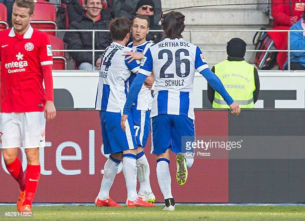 Valentin Stocker, Roy Beerens and Nico Schulz of Hertha BSC celebrate after scoring the 0:2 during the game between FSV Mainz and Hertha BSC on...