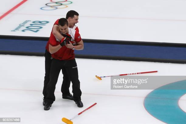 Valentin Tanner and Caludio Paetz of Switzerland celebrate after Switzerland defeated Canada during the Bronze Medal match between Canada and...