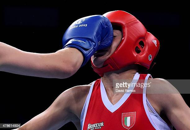 Valentina Alberti of Italy and Anastasiia Beliakova of Russia compete in the Women's Boxing Light Welterweight Final during day fourteen of the Baku...