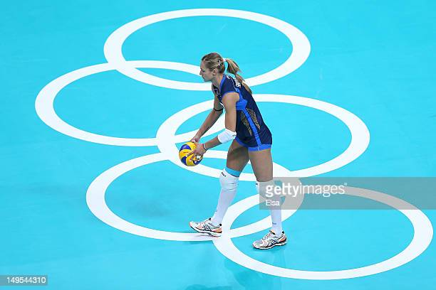 Valentina Arrighetti of Italy serves the ball in the Women's Volleyball Preliminary match between Italy and Japan on Day 3 of the London 2012 Olympic...