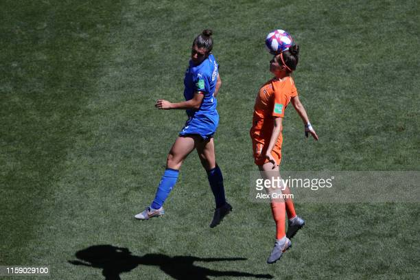 Valentina Bergamaschi of Italy jumps for the ball with Merel Van Dongen of the Netherlands during the 2019 FIFA Women's World Cup France Quarter...