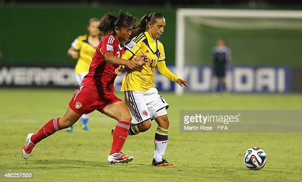Valentina Carvajal of Colombia and Ruyi Wan of China battle for the ball during the FIFA U17 Women's World Cup 2014 group D match between Paraguay...
