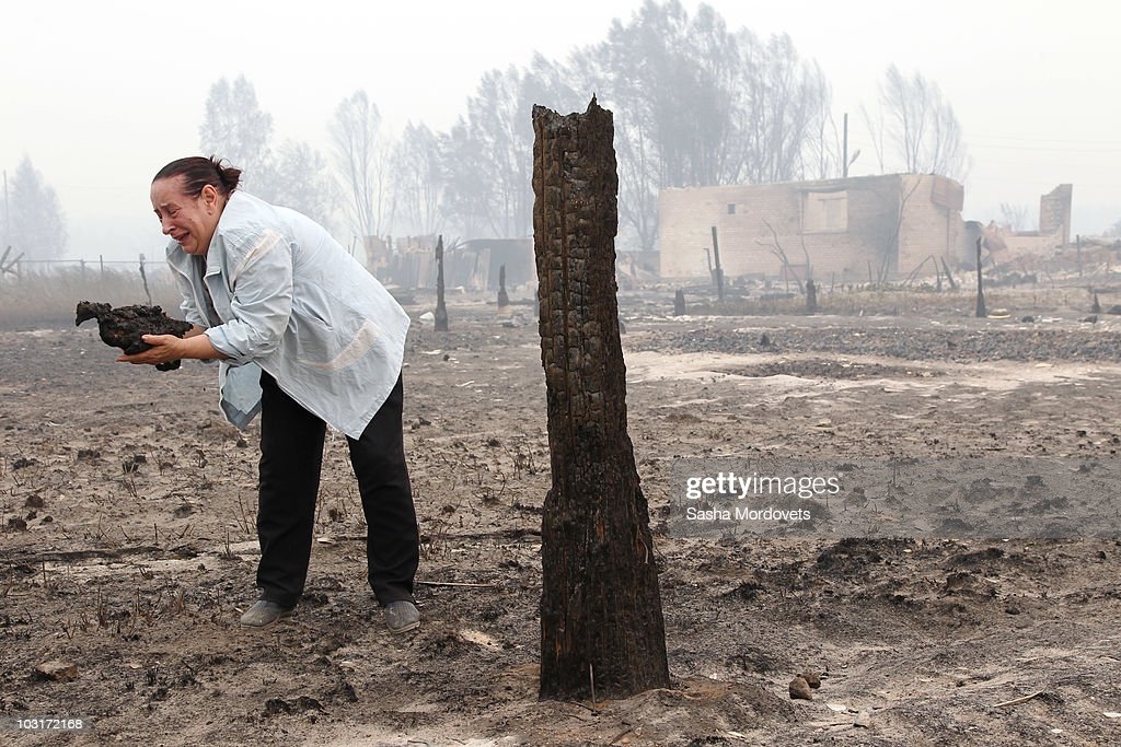 Valentina Chelysheva holds her burned hen found by her house on July 30, 2010 in Verkhnyaya Vereya, Russia. Putin visited the village where all 341 homes have burned to the ground. The Kremlin called the army to help assist as fires rage over 214,136 acres throughout vast sections of Russia. A state of emergency was ordered on Friday as firefighters continued to save cillages and forerests from the blaze.
