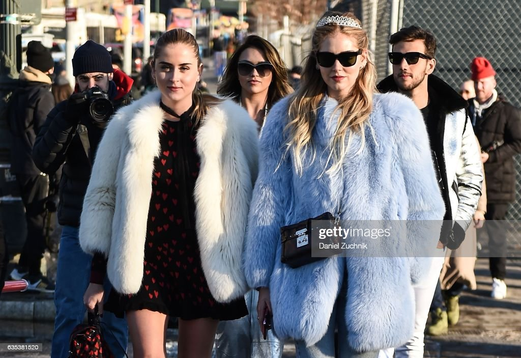 Valentina Ferragni and Chiara Ferragni are seen wearing fur coats outside the Coach show during New York Fashion Week: Women's Fall/Winter 2017 on February 14, 2017 in New York City.