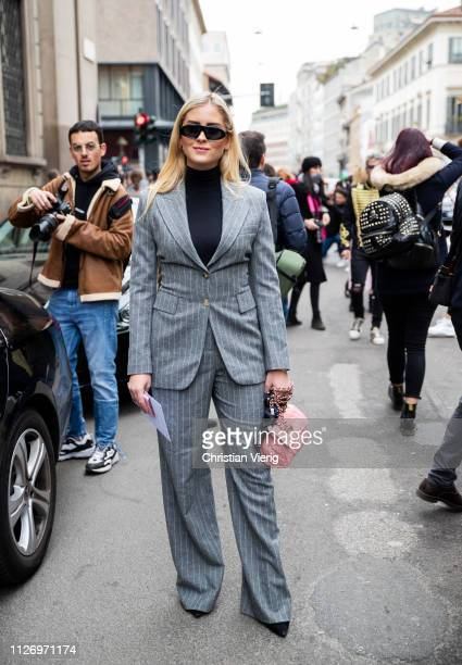 Valentina Ferragni wearing grey striped suit attends the Ermanno Scervino show at Milan Fashion Week Autumn/Winter 2019/20 on February 23 2019 in...