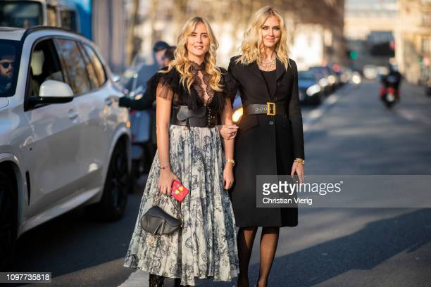 Valentina Ferragni wearing sheer ruffled top skirt with print and Chiara Ferragni wearing belted coat seen outside Dior during Paris Fashion Week...