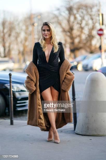 Valentina Ferragni wears a a black glittering lamé mini dress with a plunging neckline, a camel MaxMara fluffy coat, nude-color shiny pointy heeled...