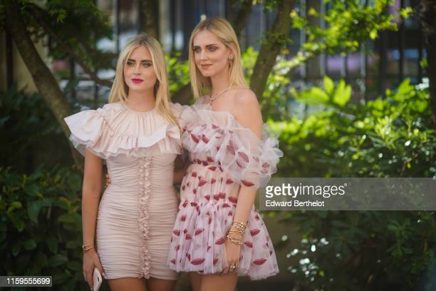 Valentina Ferragni wears a pink ruffled and pleated dress Chiara Ferragni wears an offshoulder ruffled lace dress with printed red lips outside...