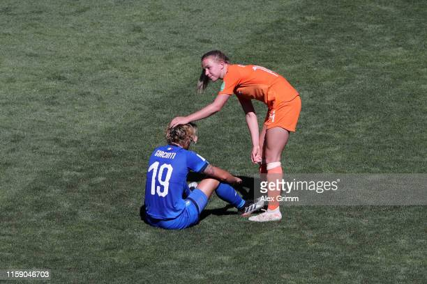 Valentina Giacinti of Italy is consoled by Jackie Groenen of the Netherlands during the 2019 FIFA Women's World Cup France Quarter Final match...