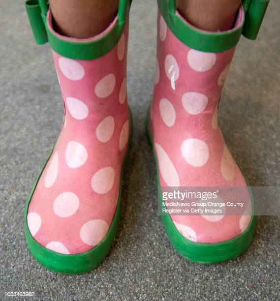 Valentina Mann wears Minnie Mouse rain boots at Pacific City shopping center in Huntington Beach on Wednesday December 21 2016
