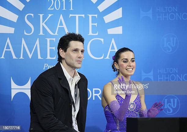 Valentina Marchei of Italy sits with coach Jason Dungjen after performing in Ladies Free Skating during Hilton HHonors Skate America at Citizens...