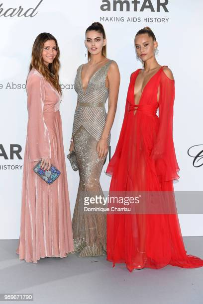 Valentina Micchetti Kamila Hansen and Chase Carter arrive at the amfAR Gala Cannes 2018 at Hotel du CapEdenRoc on May 17 2018 in Cap d'Antibes France