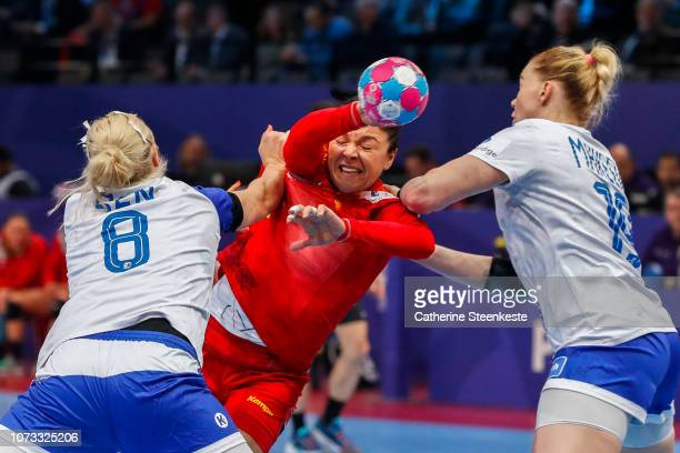 Valentina Neli ArdeanElisei of Romania tries to shoot the ball against Anna Sen and Kseniya Makeeva of Russia during the EHF Euro semifinal match...
