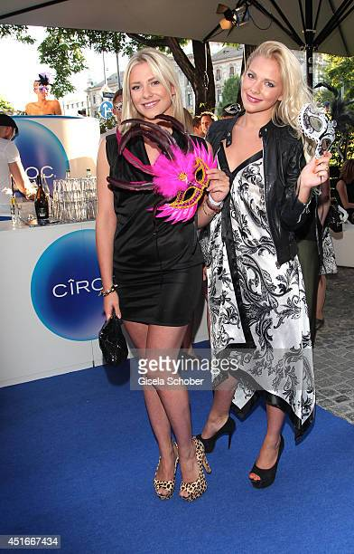 Valentina Pahde and her twin sister Cheyenne Pahde attend the CIROC VODKA Masquerade Night at Heart on July 3 2014 in Munich Germany