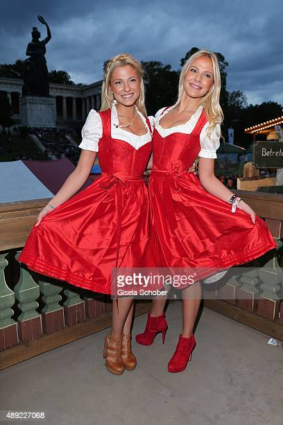 Valentina Pahde and twin sister Cheyenne Pahde wearing a dirndl by Daniel Fendler during the Oktoberfest 2015 Opening at Kaeferschaenke beer tent at...