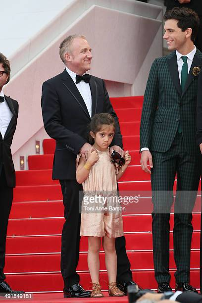 """Valentina Paloma Pinault, Francois-Henri Pinault and Singer Mika attend the """"Saint Laurent"""" premiere at the 67th Annual Cannes Film Festival on May..."""
