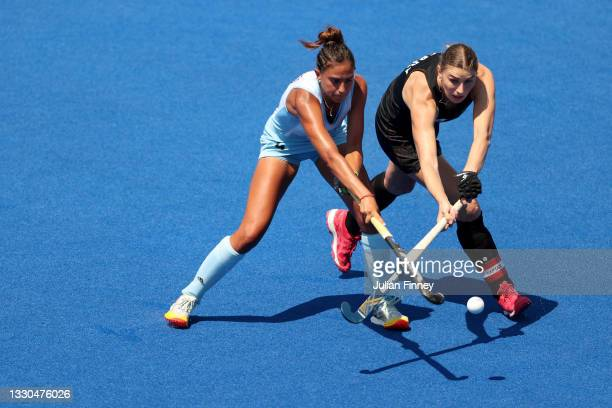 Valentina Raposo Ruiz de los Llanos of Team Argentina and Olivia Merry of Team New Zealand battle for a loose ball during the Women's Pool B match on...