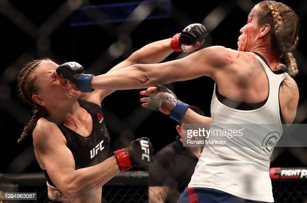 Valentina Shevchenko and Katlyn Chookagian in their Women's Flyweight Championship bout during UFC 247 at Toyota Center on February 08 2020 in...