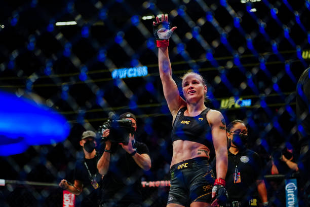 Valentina Shevchenko celebrates after defeating Lauren Murphy in their Flyweight title fight during UFC 266 at T-Mobile Arena on September 25, 2021...