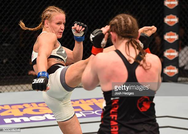 Valentina Shevchenko kicks Sarah Kaufman in their women's bantamweight bout during the UFC Fight Night event at the Amway Center on December 19 2015...