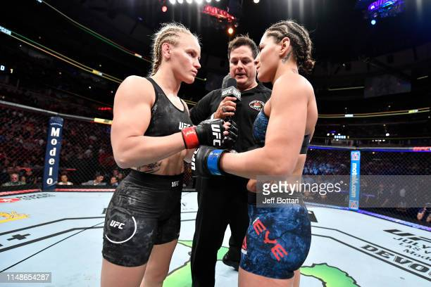 Valentina Shevchenko of Kyrgyzstan and Jessica Eye face off prior to their women's flyweight championship bout during the UFC 238 event at the United...