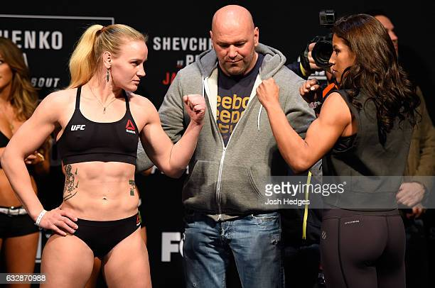 Valentina Shevchenko of Kyrgyzstan and Julianna Pena face off during the UFC Fight Night weighin at the Pepsi Center on January 27 2017 in Denver...