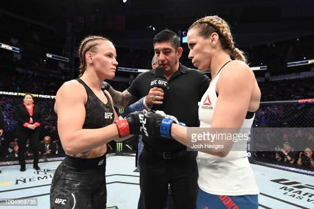Valentina Shevchenko of Kyrgyzstan and Katlyn Chookagian touch gloves prior to their women's flyweight championship bout during the UFC 247 event at...