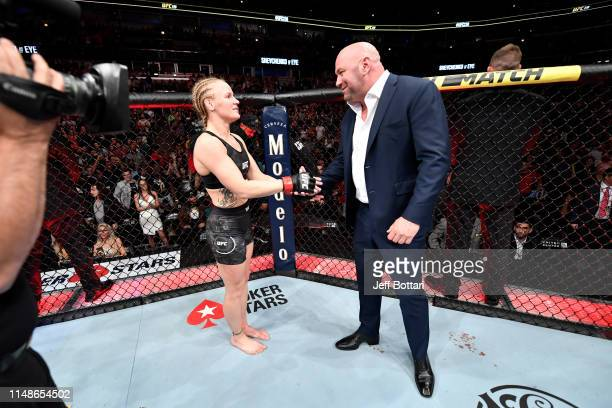 Valentina Shevchenko of Kyrgyzstan and UFC President Dana White shake hands after her KO victory over Jessica Eye in their women's flyweight...