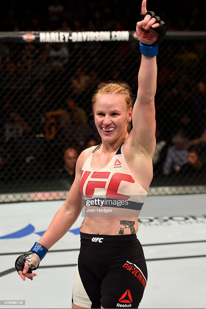 Valentina Shevchenko of Kyrgyzstan celebrates after defeating Holly Holm by unanimous decision in their women's bantamweight bout during the UFC Fight Night event at the United Center on July 23, 2016 in Chicago, Illinois.