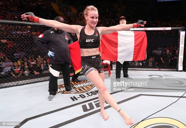 Valentina Shevchenko of Kyrgyzstan celebrates her victory over Priscila Cachoeira of Brazil in their women's flyweight bout during the UFC Fight...