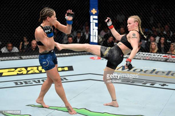Valentina Shevchenko of Kyrgyzstan kicks Jessica Eye in their women's flyweight championship bout during the UFC 238 event at the United Center on...