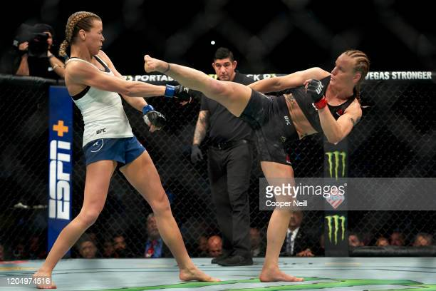 Valentina Shevchenko of Kyrgyzstan kicks Katlyn Chookagian in their women's flyweight championship bout during the UFC 247 event at Toyota Center on...