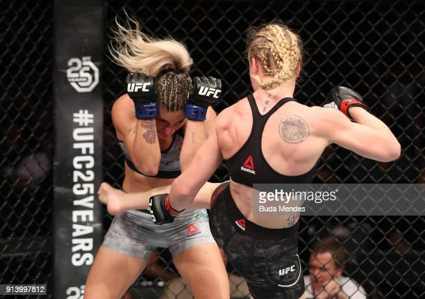 Valentina Shevchenko of Kyrgyzstan kicks Priscila Cachoeira of Brazil in their women's flyweight bout during the UFC Fight Night event at...