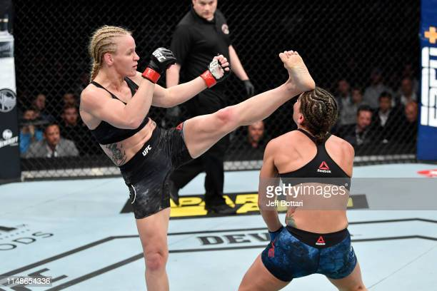 Valentina Shevchenko of Kyrgyzstan knocks out Jessica Eye in their women's flyweight championship bout during the UFC 238 event at the United Center...