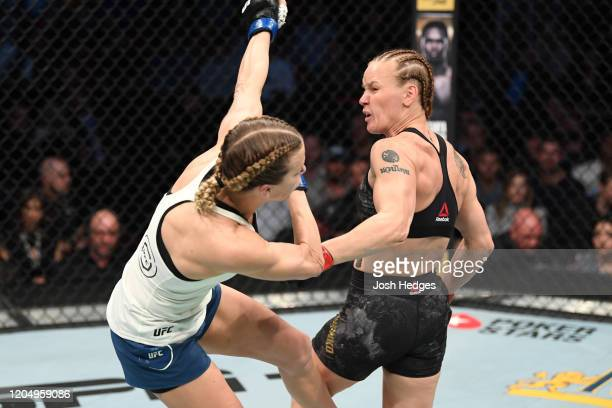 Valentina Shevchenko of Kyrgyzstan lands a spinning backfist against Katlyn Chookagian in their women's flyweight championship bout during the UFC...