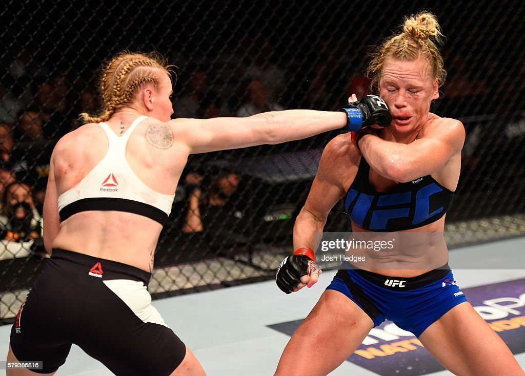 Valentina Shevchenko of Kyrgyzstan punches Holly Holm in their women's bantamweight bout during the UFC Fight Night event at the United Center on July 23, 2016 in Chicago, Illinois.