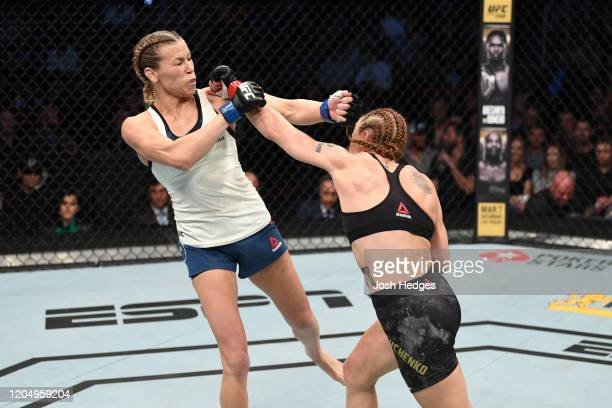 Valentina Shevchenko of Kyrgyzstan punches Katlyn Chookagian in their women's flyweight championship bout during the UFC 247 event at Toyota Center...