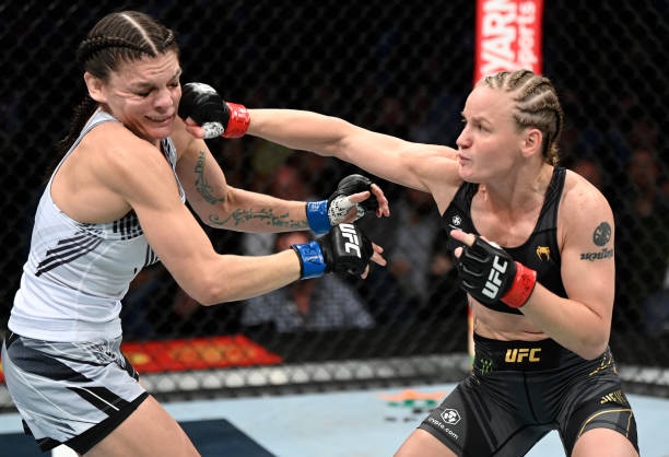Valentina Shevchenko of Kyrgyzstan punches Lauren Murphy in their UFC flyweight championship fight during the UFC 266 event on September 25, 2021 in...