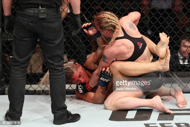 Valentina Shevchenko of Kyrgyzstan punches Priscila Cachoeira of Brazil in their women's flyweight bout during the UFC Fight Night event at...