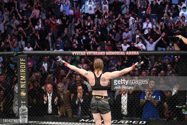 Valentina Shevchenko of Kyrgyzstan reacts after defeating Jessica Andrade of Brazil in their UFC women's flyweight championship bout during the UFC...