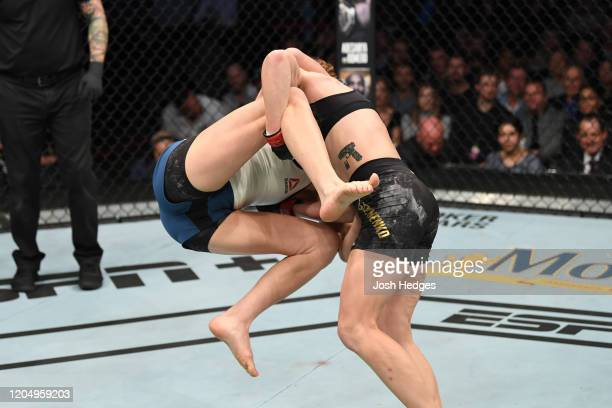 Valentina Shevchenko of Kyrgyzstan takes down Katlyn Chookagian in their women's flyweight championship bout during the UFC 247 event at Toyota...